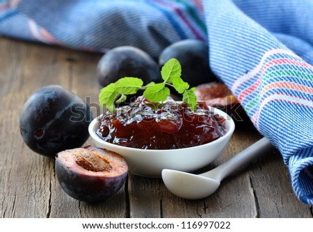 plum jam and mint in a white cup
