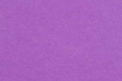 Plum purple textured cardstock paper closeup background with copy space for message or use as a texture
