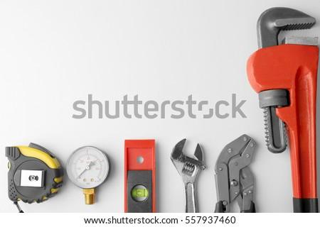 Plumber equipment on light background