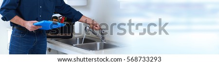 Plumber hands with clipboard.