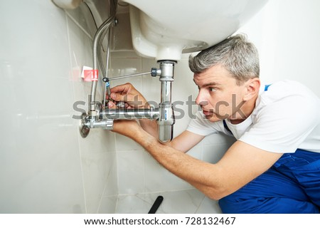 plumber man repair leaky faucet tap #728132467