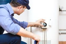 Plumber repairing an hot-water heater