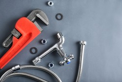 Plumber's items on grey background