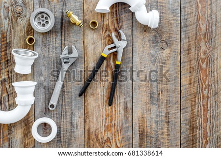 Plumber tools on wooden background top view copyspace #681338614