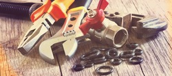 plumbing accessories  and tools closeup, horizontal header or banner, vintage faded colors toned.