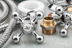 plumbing and tools in a light background. focus on the word hot