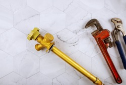 Plumbing construction water supply hose bibb outside spigot and monkey wrench adjustable