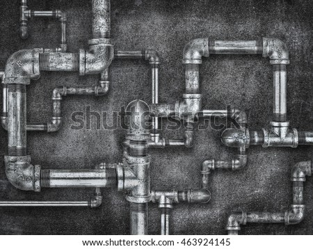 Plumbing pipes on rough wall