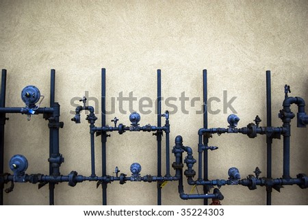 plumbing pipes on  rough wall / abstract grungy background