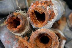Plumbing pipes with limestone and rust
