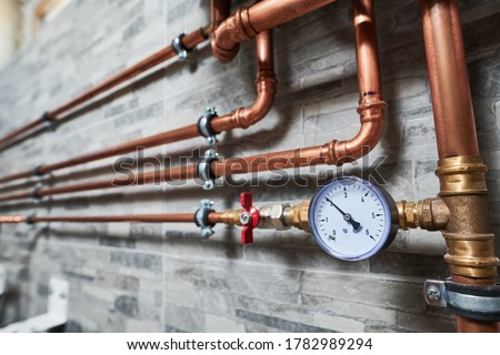 Plumbing service. copper pipeline of a heating system in boiler room ストックフォト ©