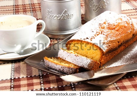 plumcake on white dish. with cappiccino cup and coffee beans