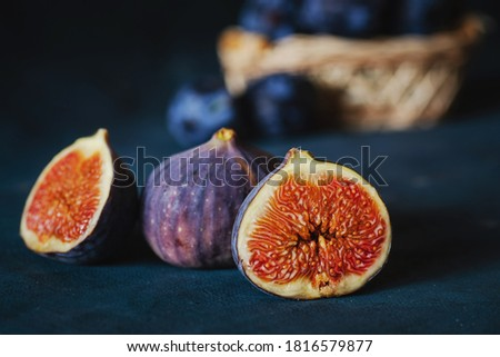 plums and figs on the table