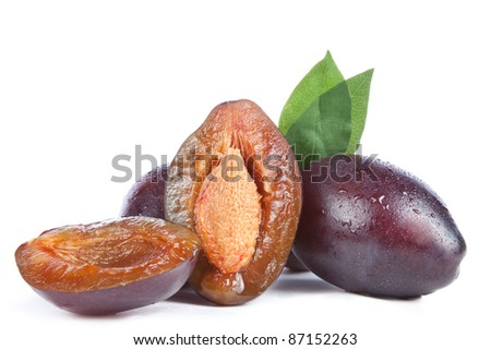plums and leaves,  isolated on a white background
