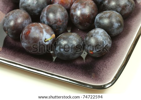 Plums on dish isolated