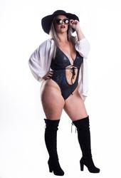 Plus Size Woman Wearing Bikini, Posing In Studio On White Background