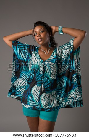 Plus Size Young African American   Woman Standing Portrait on Grey Background