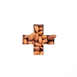 Plus summation sign or cross of nuts almonds and cut paper isolated on white. Typeface for ecofriendly food store