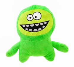 Plush green monster for little kids isolated on the white background without shadow. Front view of soft green animal toy with big ace and mall body for small kids for playing. Crazy green mascot