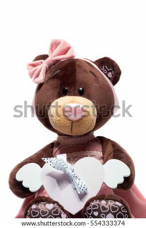 Plush toy bear sitting with heart a pink heart on isolated white background. Valentine day #554333374