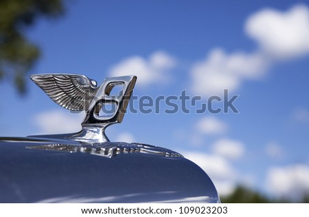 PLYMOUTH - JULY 29 : A close-up of a vintage Bentley hood ornament at the Concours D'Elegance  July 29, 2012 in Plymouth, Michigan.