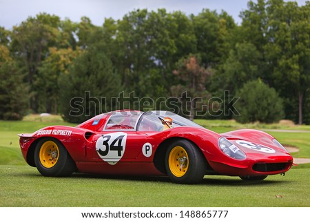 PLYMOUTH - JULY 28: A 1967 Ferrari Dino wins most significant Ferrari award at the 2013 Concours D'Elegance  July 28, 2013 Plymouth, Michigan. - stock photo