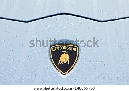 PLYMOUTH - JULY 28: A Lamborghini hood emblem in the morning dew July 28, 2013 at the Councors D'Elegance in Plymouth, Michigan.