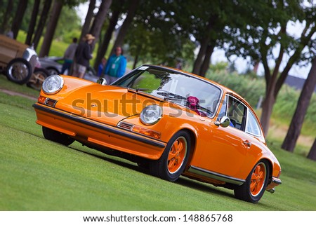 PLYMOUTH - JULY 28: A vintage Porsche 911 on display at the 2013 Concours D'Elegance  July 28, 2013 Plymouth, Michigan. - stock photo