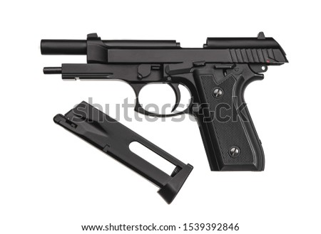 Pneumatic pistol isolated on white background. Pneumatic pistol (air gun) gun on a lighten background with a place for inscription.