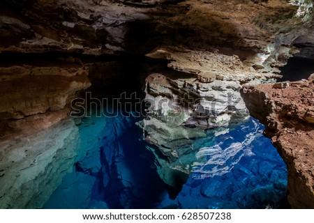Poço Azul, Cave with blue transparent water in Chapada Diamantina - Bahia, Brazil Foto stock ©