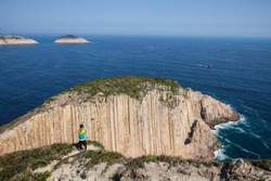 Po Pin Chau is a small island off the southeast coast of Sai Kung East Country Park in Hong Kong. It is well-known for its sheer cliffs and giant hexagonal rock columns.
