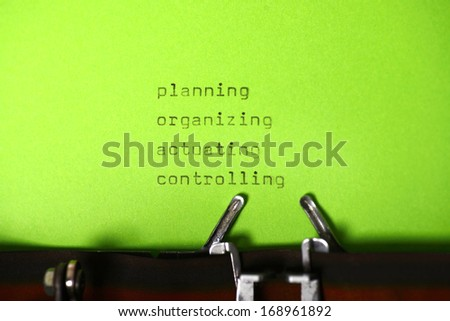POAC type on typewriter with green paper background