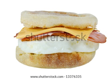 poached egg ham cheese on a english muffin - stock photo