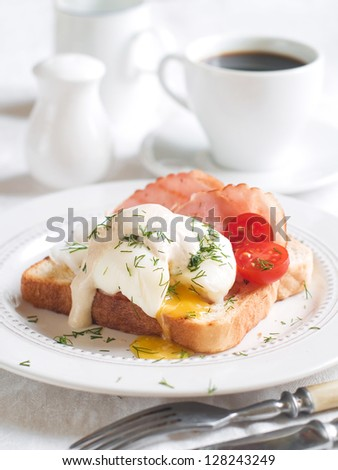 Poached egg with bacon on bread, selective focus