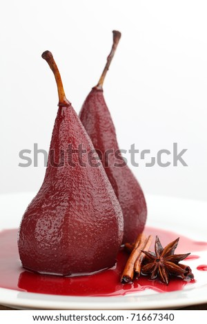 Poached pears in red wine with cinnamon and anise. Shallow dof