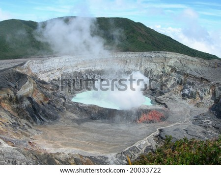 Poas Volcano Crater with misty sulfur  clouds, in Costa Rica