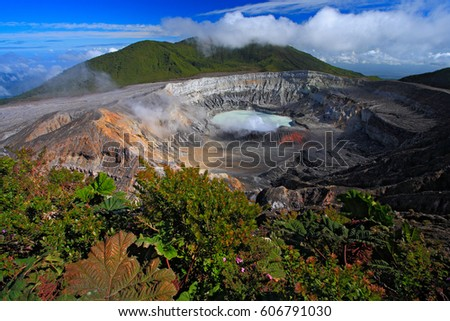 Poas volcano in Costa Rica. Volcano landscape from Costa Rica. Active volcano with blue sky with clouds. Hot lake in the crater Poas. Volcano in Costa Rica. The crater and the lake of the hill Arenal. #606791030