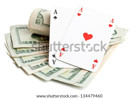 Pocket aces on dollar bills on white background