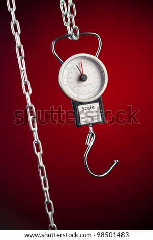 pocket balance scales on red