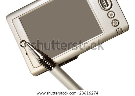 Pocket PC and pen under the light background