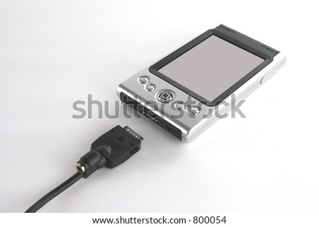 Pocket PC and sync cord isolated over white background