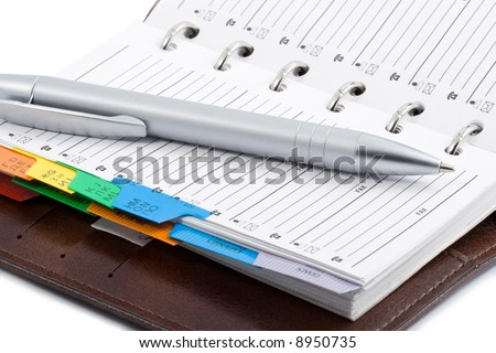pocket planner and pen isolated