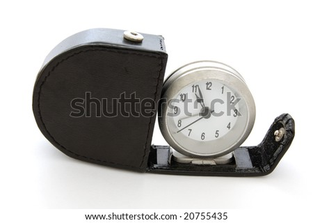 Pocket travel alarm clock and leather case isolated on white background