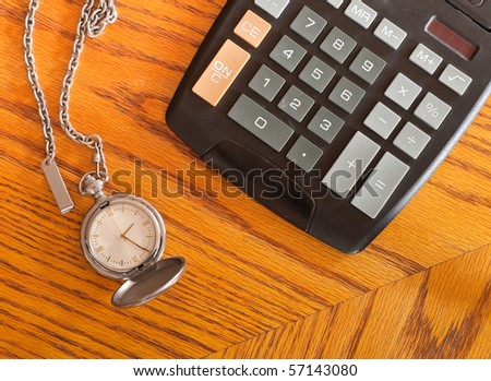 Pocket Watch and Calculator ( Money Market Concept )