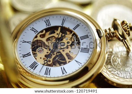 Pocket watch and gold coins concept for investment or time is money