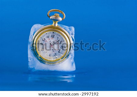 Pocket watch breaking free from a block of ice.  The clock face is clearly visible through the cracked and broken ice.  Image three in a series of three.  Free time.