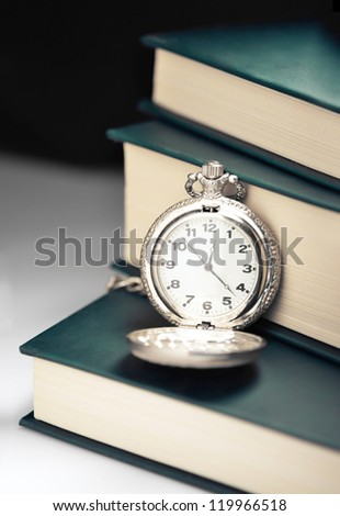 Pocket watch on a pile of books