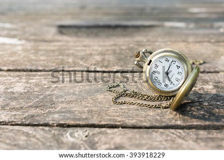 Pocket watch on old wood