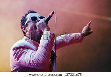 PODBORANY - AUGUST 25: Singer Rodney P. of Dub Pistols during performance on festival Rock for Churchill in Podborany, Czech republic, August 25, 2012 - stock photo