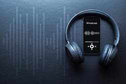 Podcast audio equipment. Audio microphone, sound headphones, podcast application on mobile smartphone screen. Recording sound voice on dark background. Live online radio player mockup banner